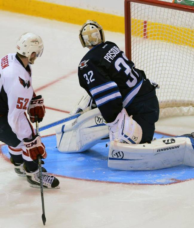 Washington Capitals' Mike Green (52) scores a shoot-out goal on Winnipeg Jets' Edward Pasquale to win 4-3 a  preseason NHL hockey game on Saturday, Sept. 14, 2013, in Belleville, Ontario