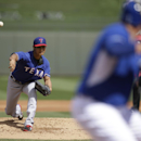 Texas Rangers' Yu Darvish of Japan delivers to Kansas City Royals' Billy Butler in the first inning of an exhibition baseball, Thursday Feb. 27, 2014, in Surprise, Ariz The Associated Press