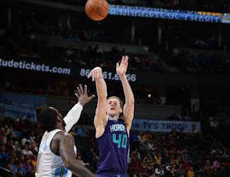 DENVER, CO - JANUARY 31: Cody Zeller #40 of the Charlotte Hornets shoots the ball against the Denver Nuggets during the game on January 31, 2015 at the Pepsi Center in Denver, Colorado. (Photo by Garrett Ellwood/NBAE via Getty Images)