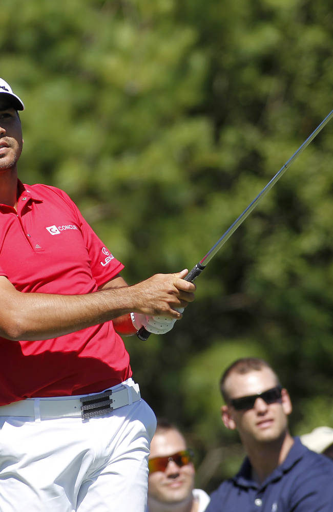 With heavy heart, Kuchar hovers around the lead