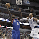 Philadelphia 76ers guard Tony Wroten (8) shoots against Dallas Mavericks forward Shawn Marion (0) during the first half of an NBA basketball game in Dallas, Monday, Nov. 18, 2013 The Associated Press