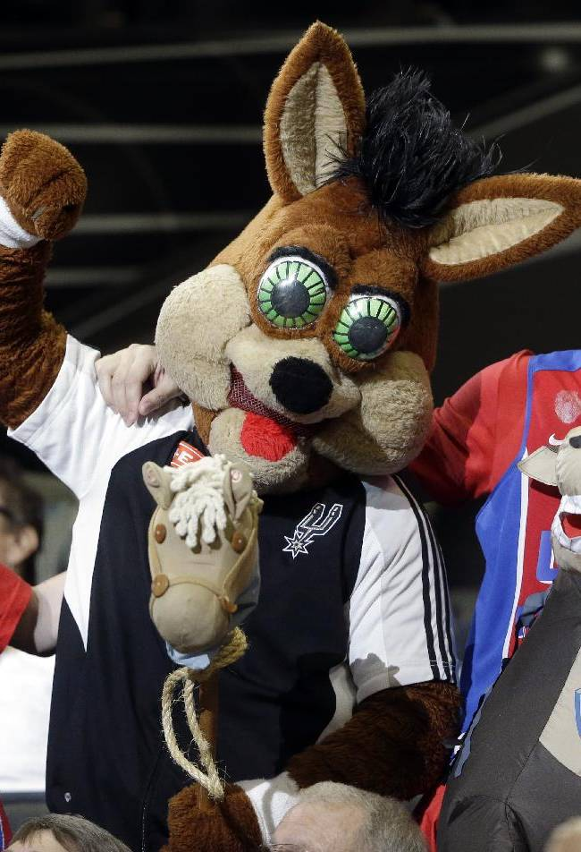 San Antonio Spurs mascot, Coyote, center, jokes with CSKA Moscow fans during the second half of an exhibition NBA basketball game against the San Antonio Spurs, Wednesday, Oct. 9, 2013, in San Antonio. San Antonio won 95-93 in overtime