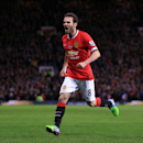 Manchester United's Juan Mata celebrates scoring his side's opening goal during their English Premier League soccer match against Crystal Palace at Old Trafford, Manchester, England, Saturday, Nov. 8, 2014