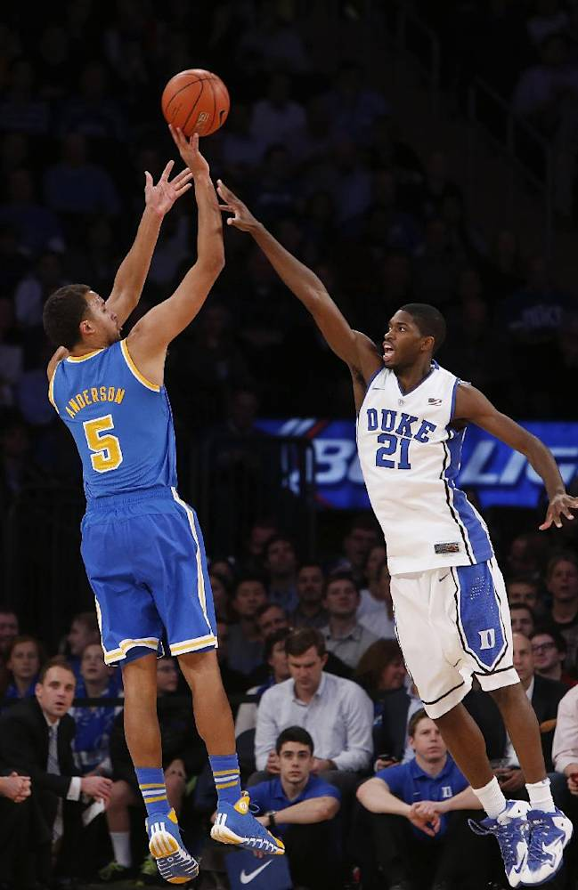 UCLA's Kyle Anderson (5) shoots against Duke's Amile Jefferson (21) during the first half of an NCAA college basketball game, Thursday, Dec. 19, 2013, in New York