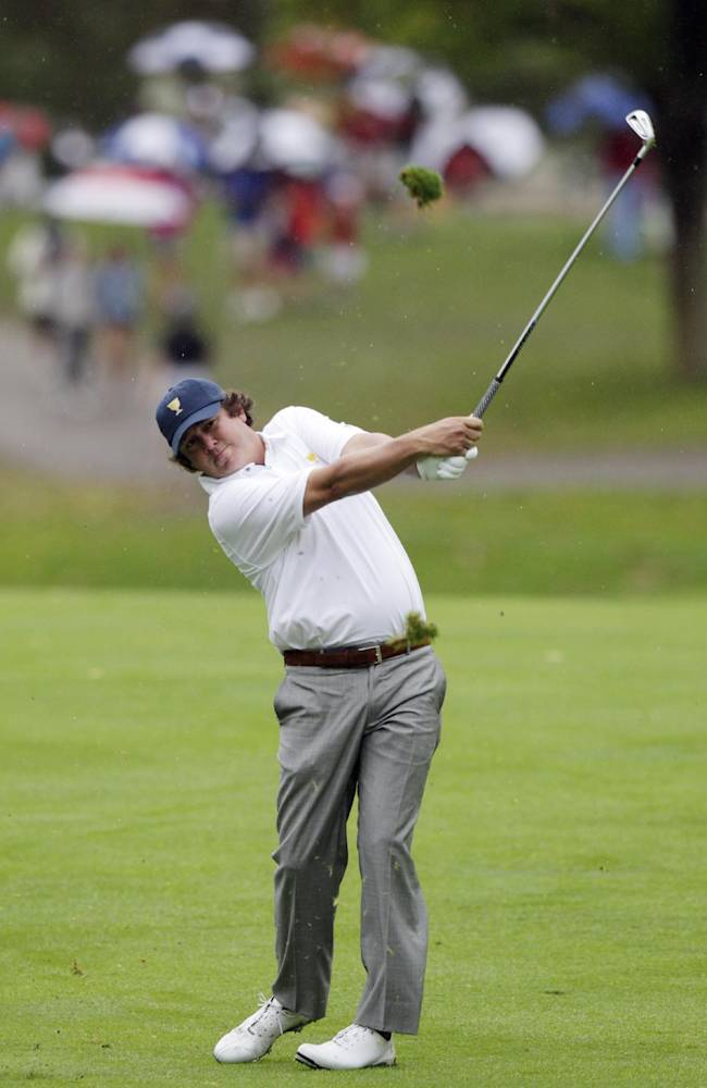 United States team player Jason Dufner hits on the sixth hole during the single matches at the Presidents Cup golf tournament at Muirfield Village Golf Club Sunday, Oct. 6, 2013, in Dublin, Ohio