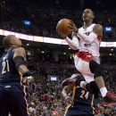 Toronto Raptors guard Terrence Ross (31) soars through the air past Indiana Pacers forwards David West (21) and Paul George (24) during the first half of an NBA basketball game Friday, April 4, 2014, in Toronto The Associated Press