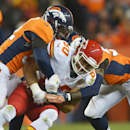 Kansas City Chiefs tight end Anthony Fasano (80) is tackled by Denver Broncos middle linebacker Wesley Woodyard (52) and outside linebacker Danny Trevathan (59) in the second quarter of an NFL football game, Sunday, Nov. 17, 2013, in Denver The Associated