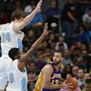 Los Angeles Lakers guard Kendall Marshall, right, is trapped with ball by Denver Nuggets guard Aaron Brooks, front left, and forward Jan Vesely, of the Czech Republic, in the fourth quarter of the Nuggets' 134-126 victory in an NBA basketball game in Denv