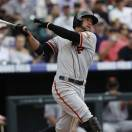 San Francisco Giants' Gregor Blanco singles against the Colorado Rockies in the fifth inning of a baseball game in Denver on Sunday, May 19, 2013. (AP Photo/David Zalubowski)