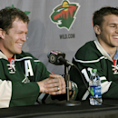 In this July 9, 2012, file photo, New Minnesota Wild NHL hockey players Ryan Suter, left, and Zach Parise are introduced during a news conference in St. Paul, Minn. Zach Parise returns to practice with the Minnesota Wild, Friday, Jan. 9, 2015, two days a