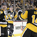 Pittsburgh Penguins' Blake Comeau (17) celebrates his second goal of the game with Evgeni Malkin (71), and Chris Kunitz (14) during the second period of an NHL hockey game against the Toronto Maple Leafs in Pittsburgh Wednesday, Nov. 26, 2014 The Associat