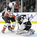 Los Angeles Kings goalie Jonathan Quick, right, deflects a shot by Anaheim Ducks' Ryan Kesler during the first period of an NHL hockey game Saturday, Nov. 15, 2014, in Los Angeles The Associated Press