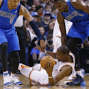 Dallas Mavericks forward Shawn Marion (0) and center Samuel Dalembert (1) reach for the ball held by Oklahoma City Thunder forward Kevin Durant (35) in the first quarter of an NBA basketball game in Oklahoma City, Sunday, March 16, 2014 The Associated Pre