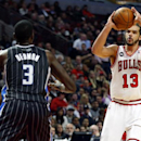 Chicago Bulls center Joakim Noah (13) shoots over Orlando Magic center Dewayne Dedmon (3) during the second half of an NBA basketball game Monday, April 14, 2014, in Chicago. The Bulls won the game 108-95 The Associated Press