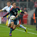 Bayern's Philipp Lahm, front, and Manchester City's James Milner, rear, challenge for the ball during the Champions League group D soccer match between FC Bayern Munich and Manchester City, in Munich, southern Germany, Tuesday, Dec. 10, 2013. Manchester d