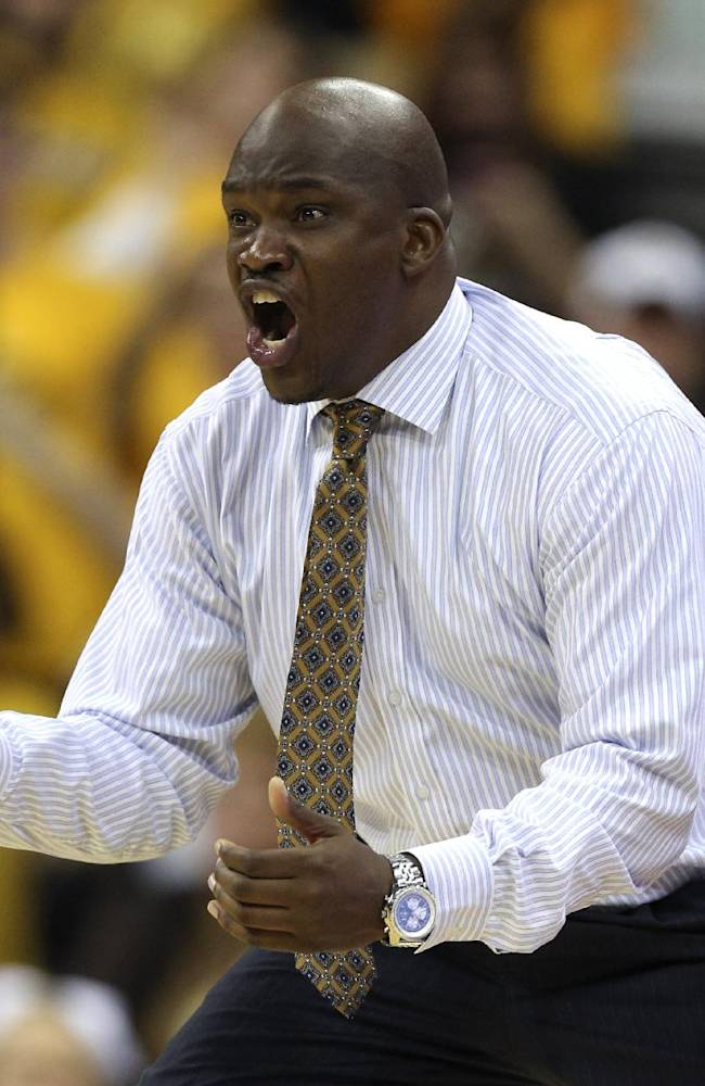 Missouri associate head coach Tim Fuller reacts to a score during the second half of an NCAA college basketball game against Hawaii, Saturday, Nov. 16, 2013, in Kansas City, Mo. Missouri won 92-80