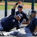 New York Yankees' Jacoby Ellsbury, center, Brian McCann, rear, and Carlos Beltran stretch before an exhibition spring training baseball game against the Detroit Tigers in Lakeland, Fla., Friday, Feb. 28, 2014 The Associated Press
