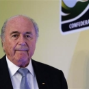 FIFA President Sepp Blatter arrives to a media briefing to discusss the Confederations Cup and the latest preparations for next year's World Cup finals in Brazil, in Rio de Janeiro July 1, 2013. REUTERS/Sergio Moraes (BRAZIL - Tags: SPORT SOCCER) - RTX118YM