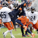 Chicago Bears wide receiver Brandon Marshall (15) runs with a ball against linebacker Lance Briggs (55) and cornerback Kelvin Hayden (24) during NFL football training camp at Olivet Nazarene University on Saturday, July 26, 2014, in Bourbonnais, Ill The A