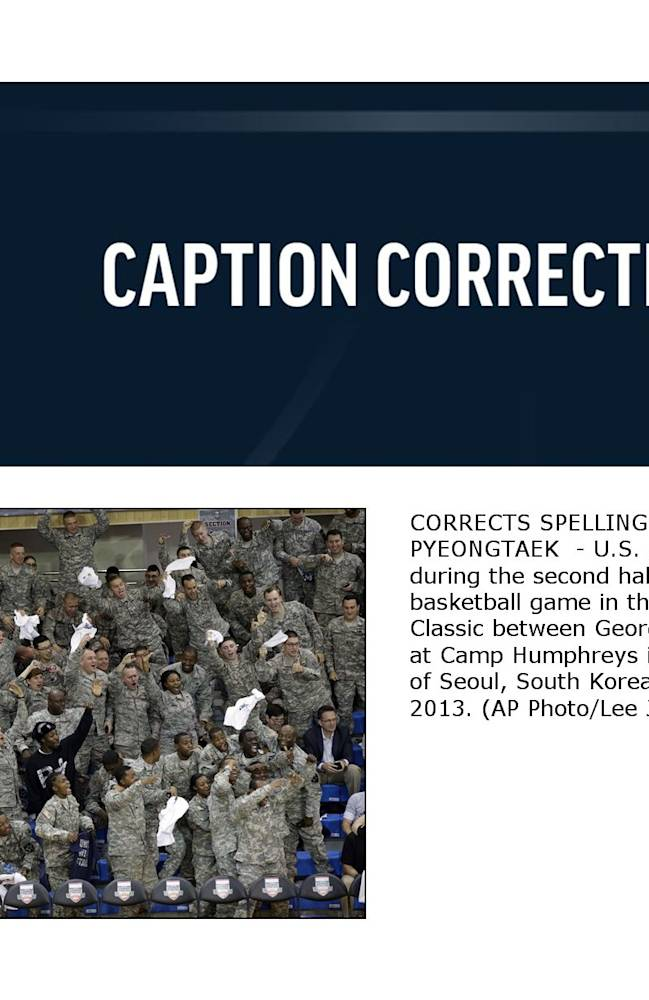 CORRECTS SPELLING OF CITY TO PYEONGTAEK  - U.S. Army soldiers cheer during the second half of an NCAA college basketball game in the Armed Forces Classic between Georgetown and Oregon at Camp Humphreys in Pyeongtaek, south of Seoul, South Korea, Saturday, Nov. 9, 2013