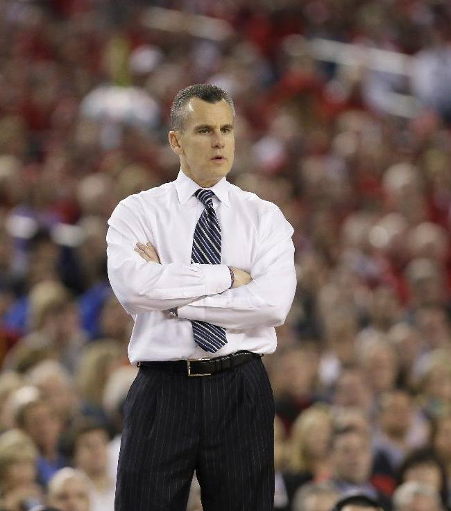 Florida head coach Billy Donovan looks on during the second half of an NCAA Final Four tournament college basketball semifinal game against Connecticut Saturday, April 5, 2014, in Arlington, Texas. Connecticut won 63-53