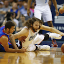 Charlotte Bobcats forward Josh McRoberts, right, fights for a loose ball against Philadelphia 76ers guard Michael Carter-Williams, left, during the first half of an NBA basketball game in Charlotte, N.C., Saturday, April 12, 2014. (AP Photo/Chris Keane)