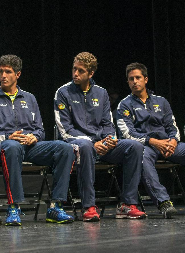 Ecuador Davis Cup Team, from left, Julio-Cesar Campozano, Emilio Gomez, Roberto Quiroz, Gonzalo Escobar and Raul Viver, captain of the Ecuador's Davis Cup Team, listen to a speech during the drawing for the tennis Davis Cup World Group Play-off round match between Switzerland and Ecuador, in Neuchatel, Switzerland, Thursday, Sept. 12, 2013. Switzerland will play against Ecuador for the Davis Cup World Group Play-off round matches starting on Sept. 13 in Neuchatel