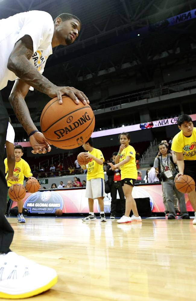 Indiana Pacers' Paul George conducts a basketball clinic for Filipino Special Olympics athletes Wednesday, Oct. 9, 2013, at the Mall of Asia Arena in Pasay city, south of Manila, Philippines. The Indiana Pacers will play against the Houston Rockets on Thursday in the first NBA game in this basketball-obsessed Southeast Asian nation, part of the NBA's global schedule that will have eight teams play in six countries this month