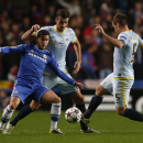 Chelsea's Eden Hazard, left, competes with Steaua Bucharest's Lukasz Szukala, center, and Mihai Pintilii during their Champions League group E soccer match at Stamford Bridge, London, Wednesday, Dec. 11, 2013