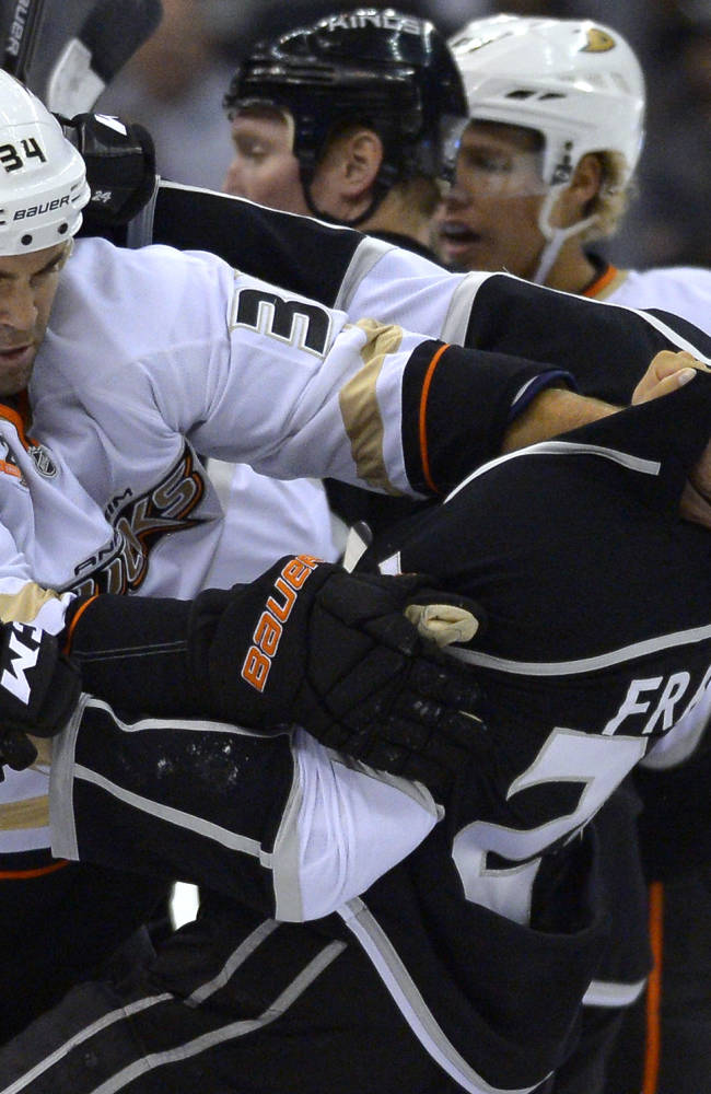 Anaheim Ducks left wing Daniel Winnik, left, and Los Angeles Kings center Colin Fraser scuffle during the first period of an NHL preseason hockey game, Tuesday, Sept. 24, 2013, in Los Angeles