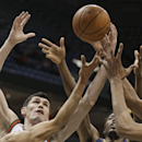 Milwaukee Bucks' Ersan Ilyasova, left, and New Orleans Pelicans' Al-Farouq Aminu reach for a rebound during the first half of an NBA basketball game Wednesday, Feb. 12, 2014, in Milwaukee The Associated Press