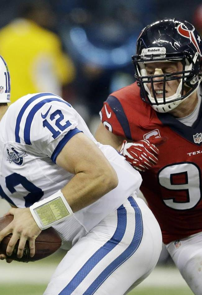 Indianapolis Colts' Andrew Luck (12) is pressured by Houston Texans' J.J. Watt during the second quarter of an NFL football game Sunday, Nov. 3, 2013, in Houston