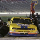Timmy Hill (13) pits during the NASCAR Xfinity series auto race at Texas Motor Speedway in Fort Worth, Texas, Friday, April 10, 2015. (AP Photo/Tim Sharp)