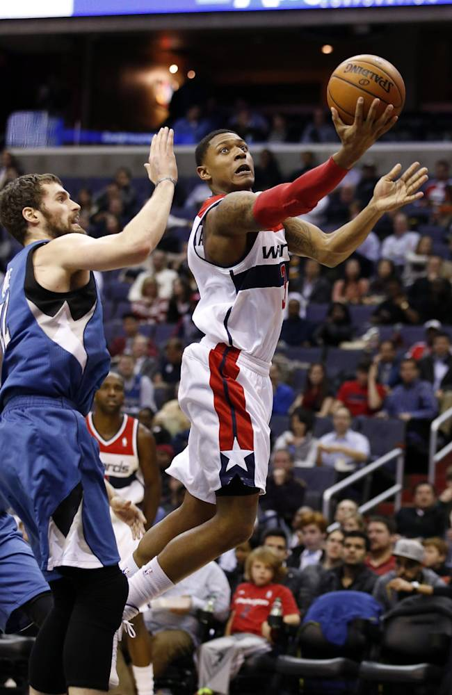 Washington Wizards guard Bradley Beal (3) shoots in front of Minnesota Timberwolves forward Kevin Love (42) in the second half of an NBA basketball game Tuesday, Nov. 19, 2013, in Washington. Beal had 25 points and the Wizards won 104-100