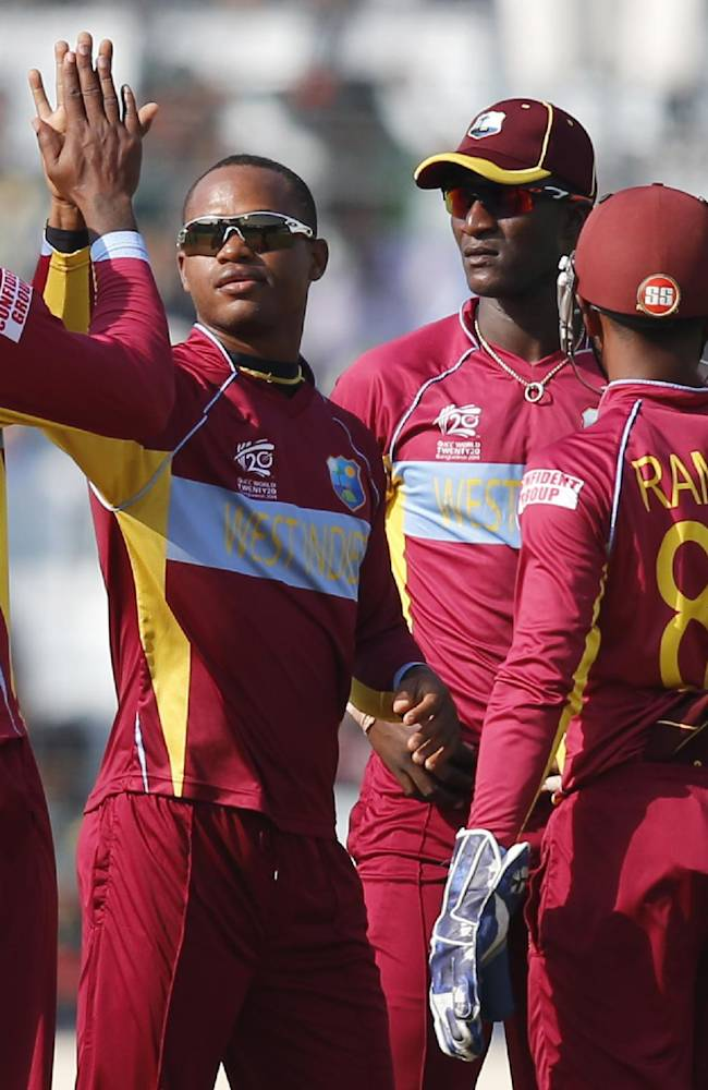 West Indies' bowler Marlon Samuels, second left, celebrates with teammates the dismissal of Australia's batsman Aaron Finch during their ICC Twenty20 Cricket World Cup match in Dhaka, Bangladesh, Friday, March 28, 2014