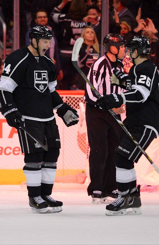 Los Angeles Kings defenseman Robyn Regehr, left, of Brazil, celebrates his game-winning goal with teammate defenseman Slava Voynov, of Russia, during the overtime period of an NHL hockey game against the Columbus Blue Jackets, Thursday, Feb. 6, 2014, in Los Angeles