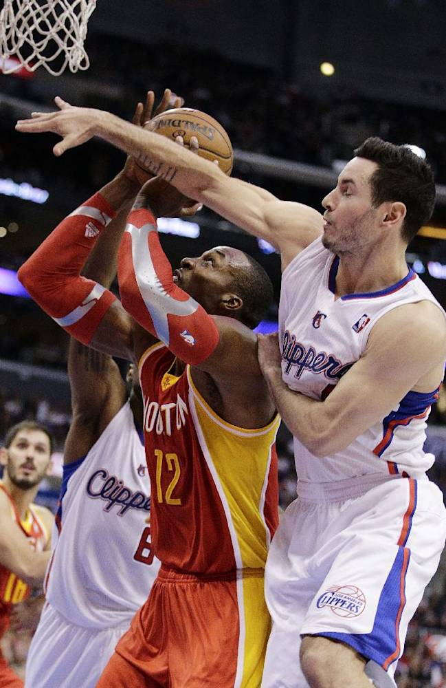 Houston Rockets' Dwight Howard, left, is defended by Los Angeles Clippers' J.J. Redick during the second half of an NBA basketball game on Monday, Nov. 4, 2013, in Los Angeles. The Clippers won 137-118