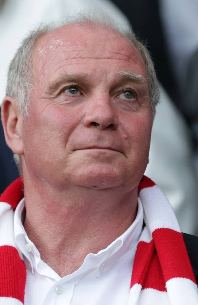 In this Aug. 27, 2013 file photo Bayern Munich president Uli Hoeness watches the German first division Bundesliga soccer match between SC Freiburg and FC Bayern Munich, in Freiburg, southern Germany. German prosecutors say they have searched tax offices in Bavaria as they investigate who leaked a document on Hoeness' tax affairs to the media. Hoeness will go on trial in March on tax evasion charges, which prosecutors filed last year months after the Bayern president reported himself to authorities over a previously undeclared Swiss bank account