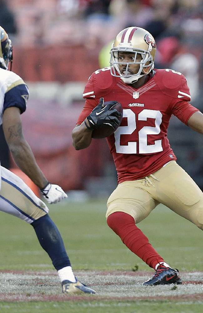 FILE - In this Dec. 1, 2013, file photo, San Francisco 49ers cornerback Carlos Rogers (22) runs against St. Louis Rams wide receiver Tavon Austin (11) after intercepting a pass from quarterback Kellen Clemens during an NFL football game in San Francisco. The 49ers have released cornerback Rogers after three seasons, an expected cost-cutting move as the NFL's free agency period begins Tuesday, March 11, 2014. (AP Photo/Marcio Jose Sanchez, File)