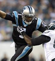 Carolina Panthers quarterback Cam Newton, left, tries to slip away from Philadelphia Eagles defensive tackle Fletcher Cox during the first half of a preseason NFL football game, Thursday, Aug. 15, 2013, in Philadelphia. (AP Photo/Matt Rourke)