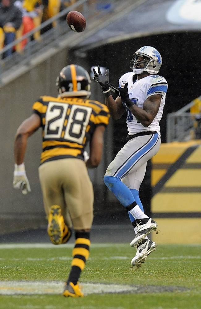 Detroit Lions wide receiver Calvin Johnson (81) makes a catch for a touchdown as Pittsburgh Steelers cornerback Cortez Allen (28) defends during the second quarter of an NFL football game on Sunday, Nov. 17, 2013, in Pittsburgh