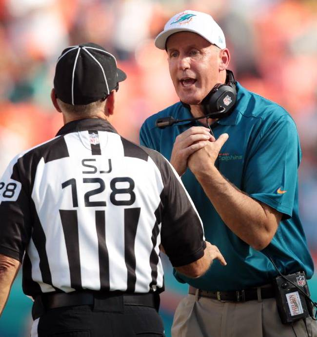 Miami Dolphins head coach Joe Philbin, right, speaks to side judge Larry Rose during the first half of an NFL football game against the Carolina Panthers, Sunday, Nov. 24, 2013, in Miami Gardens, Fla