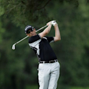 Zack Fischer tees off on the eighth hole during the first round of the U.S. Open golf tournament at Merion Golf Club, Friday, June 14, 2013, in Ardmore, Pa. (AP Photo/Julio Cortez)