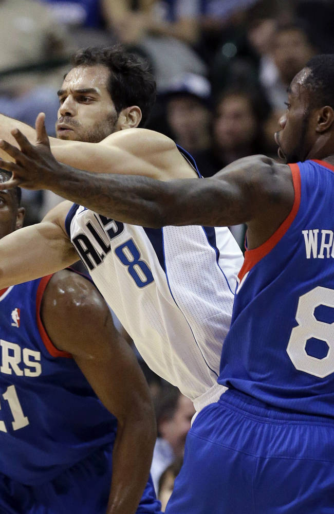 Ellis leads way in 2nd half, Mavs top 76ers 97-94
