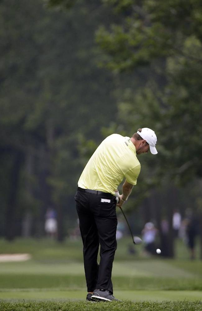 Chris Wood hits his tee shot on the 12th hole during the second round of the PGA Championship golf tournament at Valhalla Golf Club on Friday, Aug. 8, 2014, in Louisville, Ky