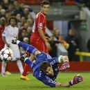 Real Madrid's goalkeeper Iker Casillas makes a save during the Champions League group B soccer match between Liverpool and Real Madrid at Anfield Stadium, Liverpool, England, Wednesday Oct. 22, 2014