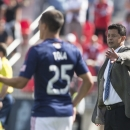 Chivas USA coach Wilmer Cabrera issues instructions on the sidelines during his team's 3-0 loss to Toronto FC during an MLS soccer game in Toronto on Sunday, Sept. 21, 2014 The Associated Press