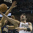 Milwaukee Bucks' Zaza Pachulia, right, shoots under the arm of Indiana Pacers' Chris Copeland during the first half of an NBA basketball game on Wednesday, April 9, 2014, in Milwaukee The Associated Press