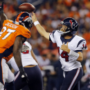 Houston Texans quarterback Ryan Fitzpatrick (14) throws as Denver Broncos defensive end Malik Jackson (97) defends during the first half of an NFL preseason football game, Saturday, Aug. 23, 2014, in Denver The Associated Press