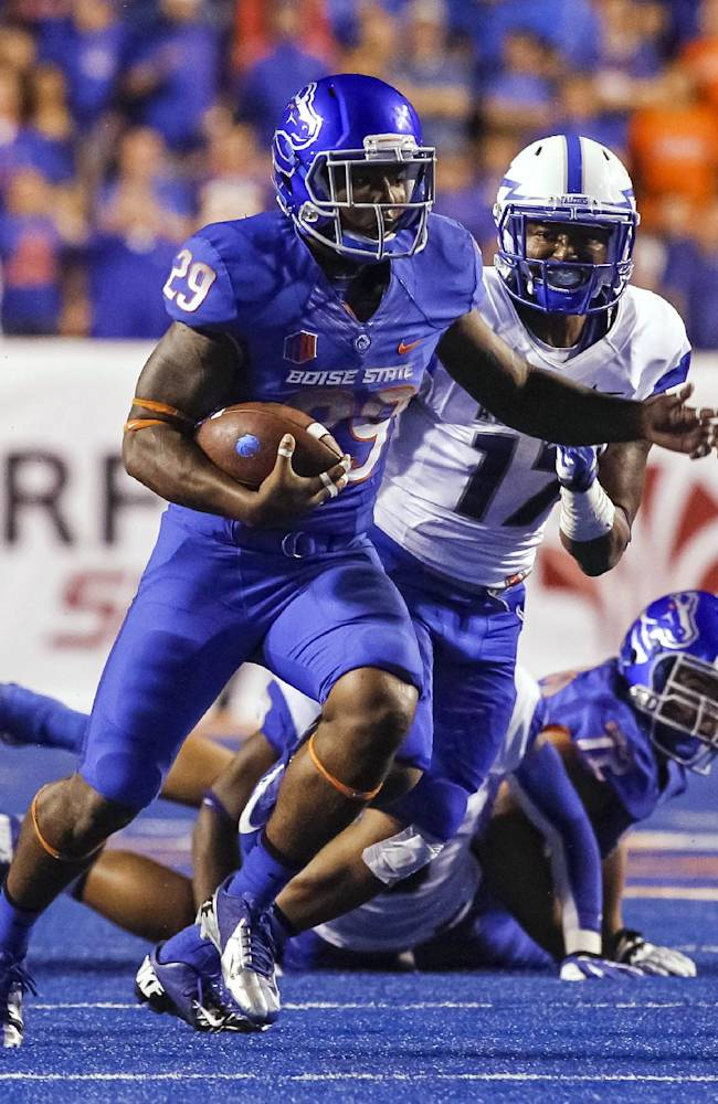 Boise State running back Aaron Baltazar (29) carries as Air Force defensive back Jamal Byrd (17) follows during the second half of an NCAA college football game in Boise, Idaho, Friday, Sept. 13, 2013. Boise State won 42-20